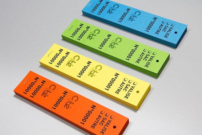 Tickets vestiaires perforés et numérotés pour accrocher aux cintres et aux valises - Oscar Productions Nantes billetterie et gestion d'accès sécurisée
